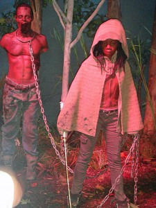 AMC's The Walking Dead display featuring Michonne and her zombie pet.