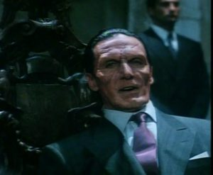 ...so naturally he looks like a rejected Dick Tracy villain for most of the film.